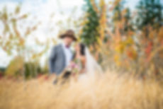 Couple portrait in autumn field