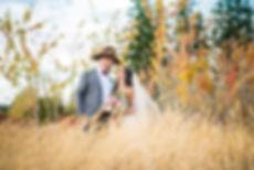 Couple portrait in autumn field