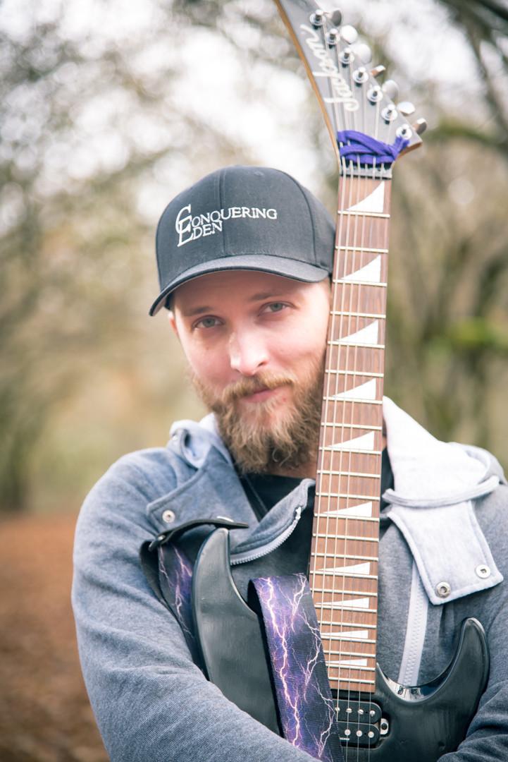 Musician holding guitar