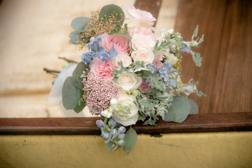 Bridal bouquet on canoe