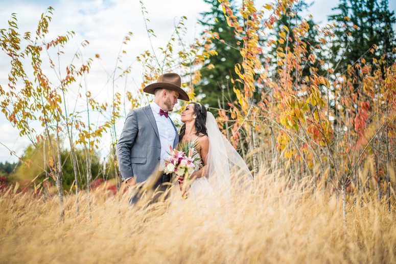 Bride and groom in autumn field