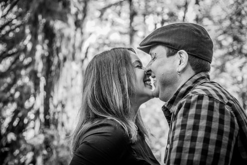 Engaged couple at Sweet Creek Falls