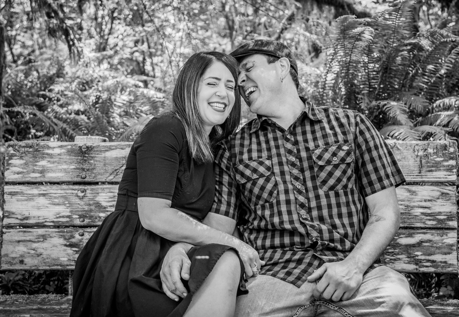 Engaged couple laughing together