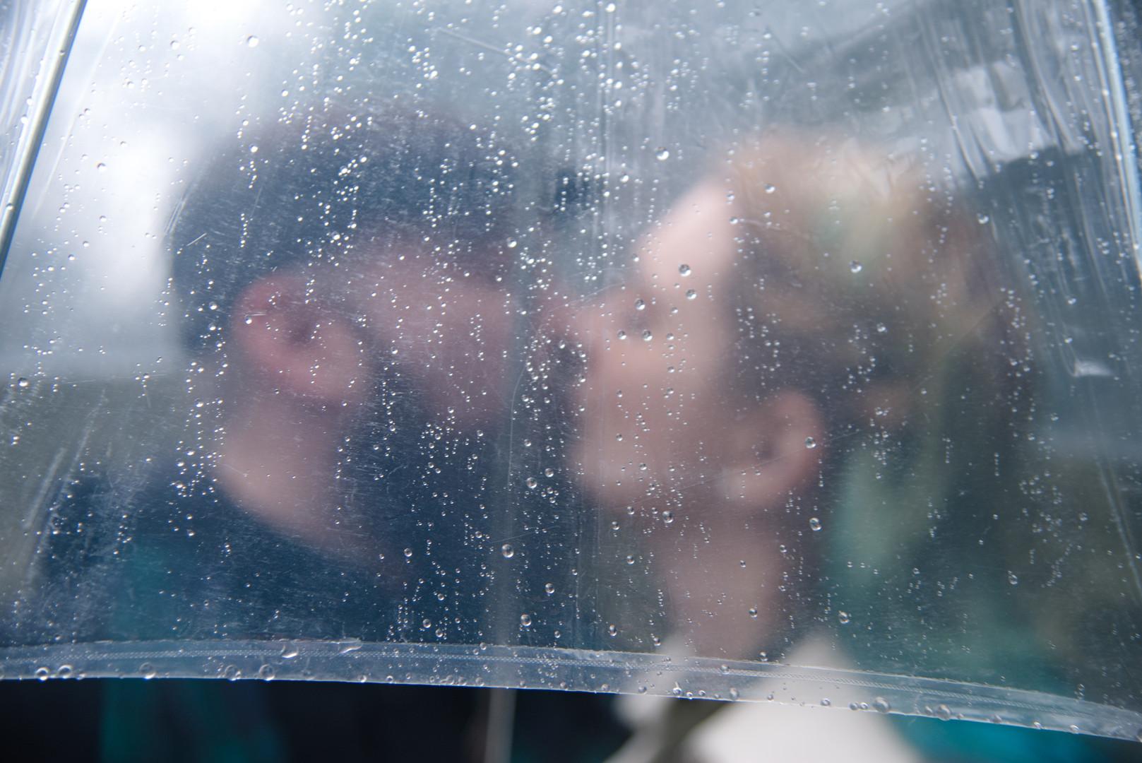 Engaged couple under an umbrella