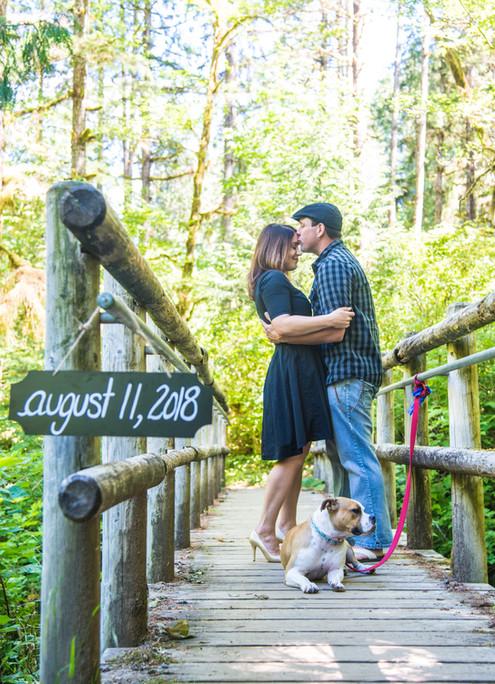 Engaged couple on bridge