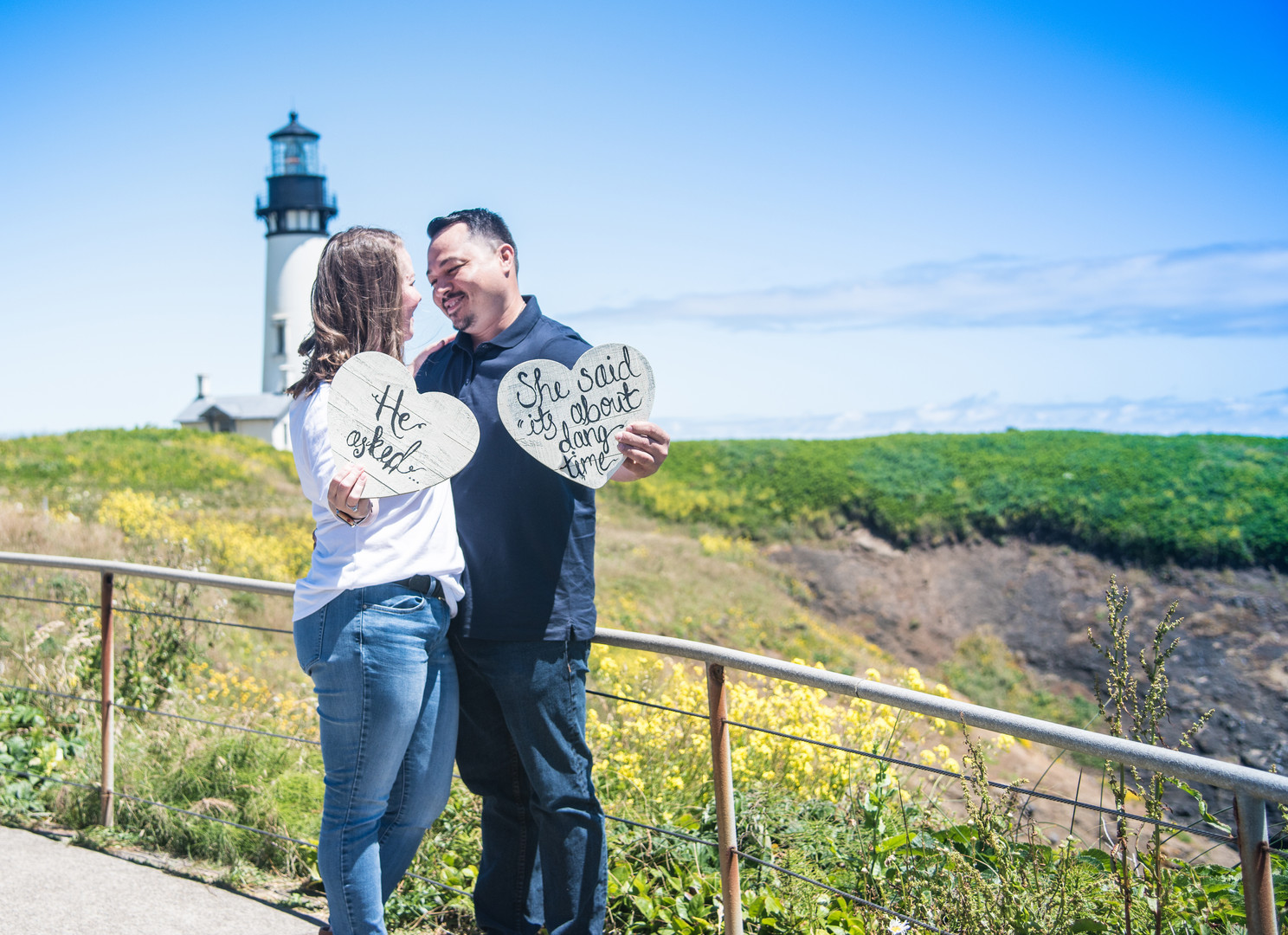 Engaged couple at Yaquina Head Lighthouse
