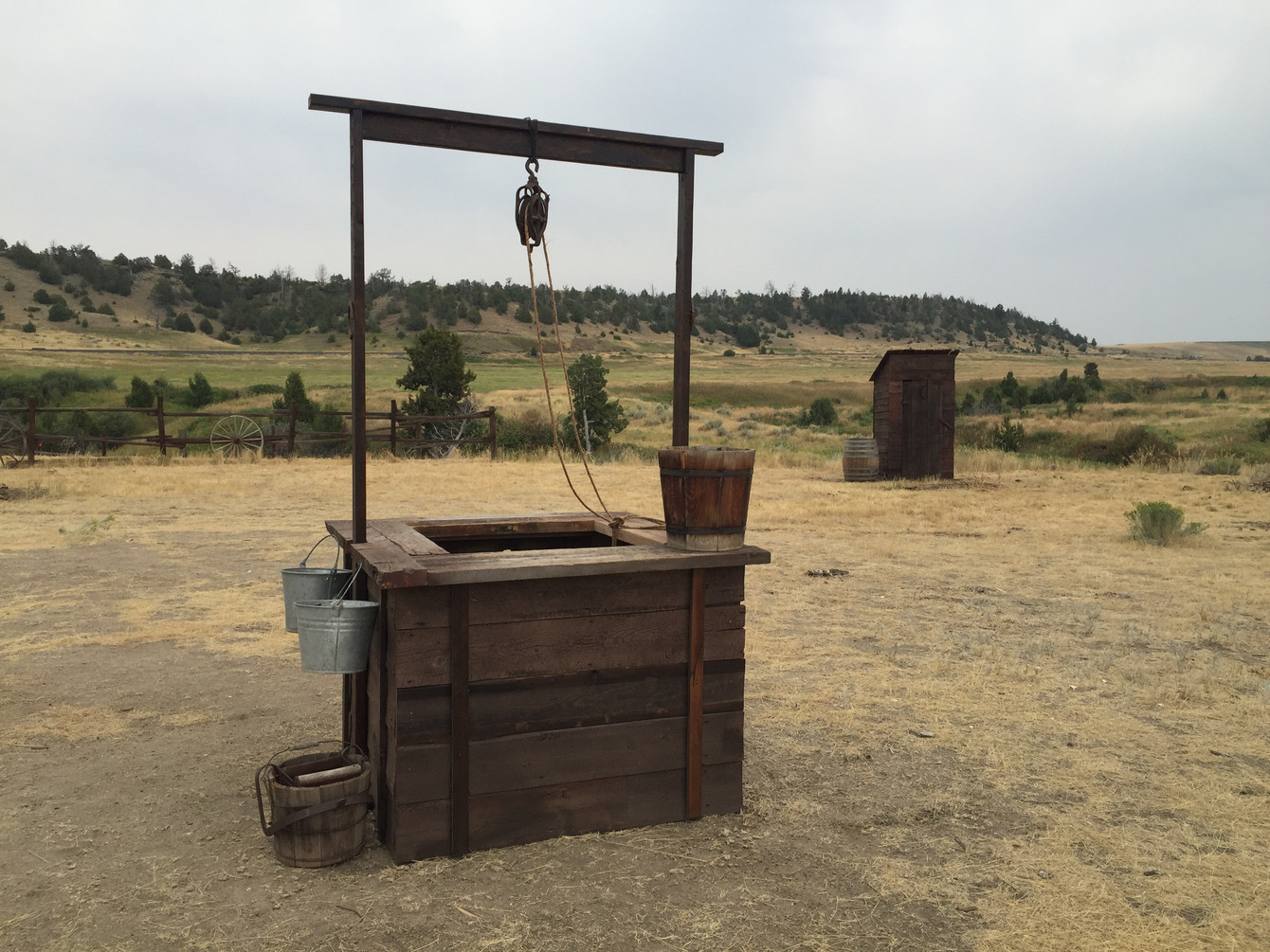 Photo - finished well & outhouse