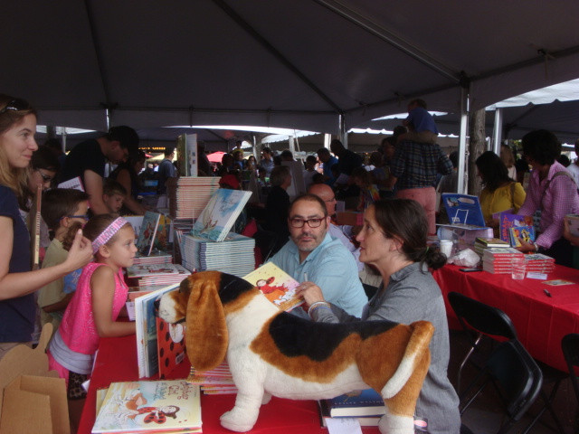 Authors with inviting materials to hook young readers at a recent festival