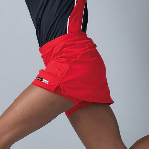 Vegan Women's Sports Skort shown in red with subtle vegan logo from Vegan Happy Clothing