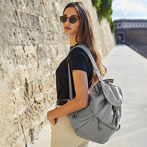 Vegan backpack vintage style with subtle vegan logo from Vegan Happy Clothing shown in pale grey
