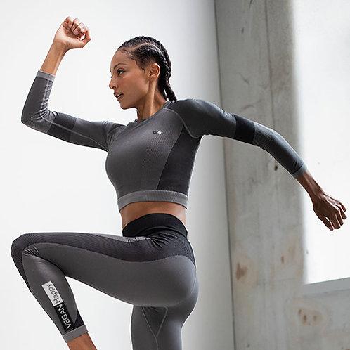 Vegan women's workout leggings with larger vegan logo up the leg from Vegan Happy Clothing