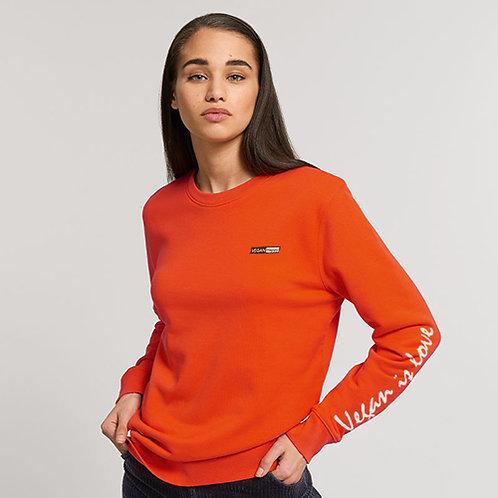 Vegan women's Vegan is love long sleeve t-shirt from Vegan Happy Clothing with subtle vegan messaging