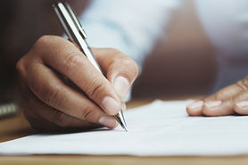 bigstock-Hand-Of-Woman-Holding-Pen-With-286245913.jpg