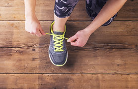 bigstock-Young-runner-tying-her-shoes-87