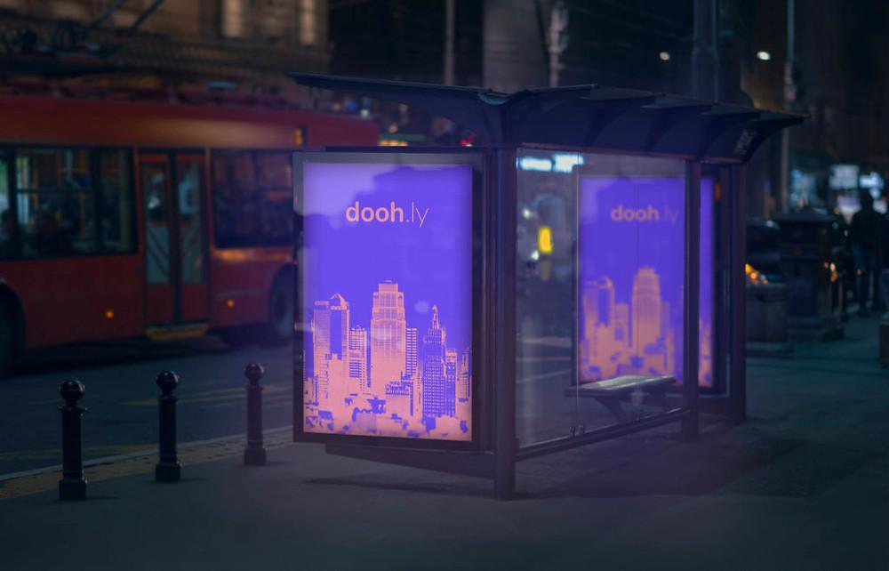 Doohly digital signage bus stop night