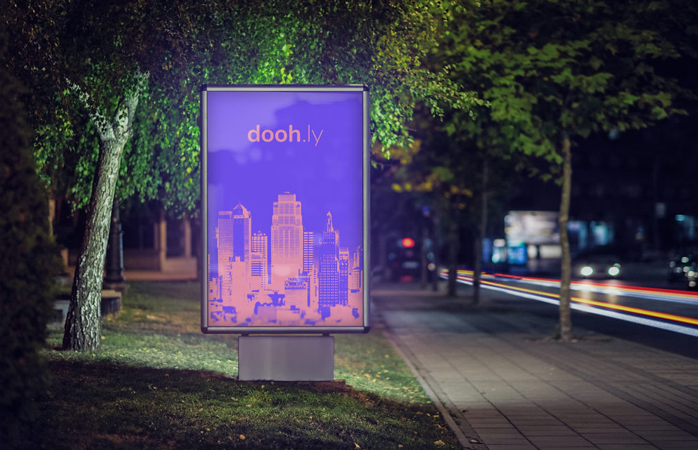 Doohly digital signage at night in park