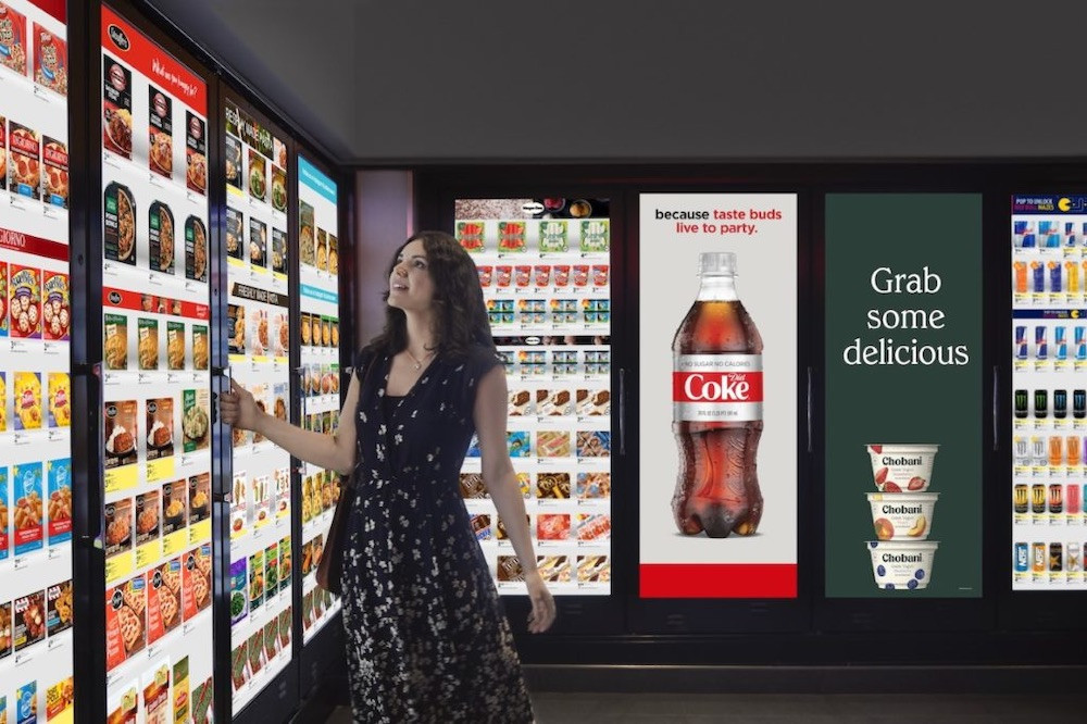 Lady in front of grocery store freezer with digital signage
