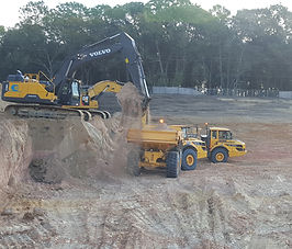 Cropped Excavator Loading End Dump with