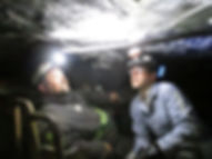 Miners Riding Mantrip out of Underground Mine
