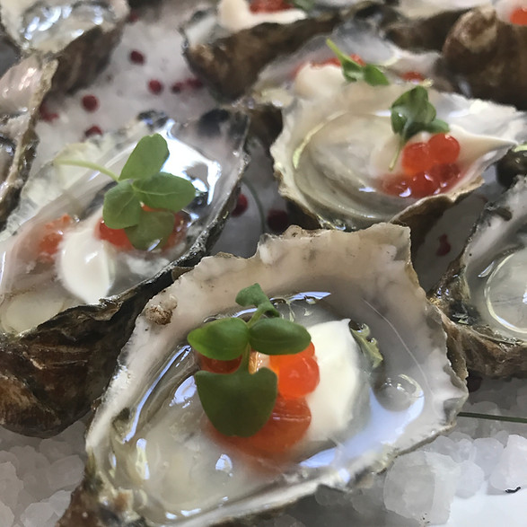 Tomales Bay Miyagi Oyster with Creme Fraiche and Salmon Roe