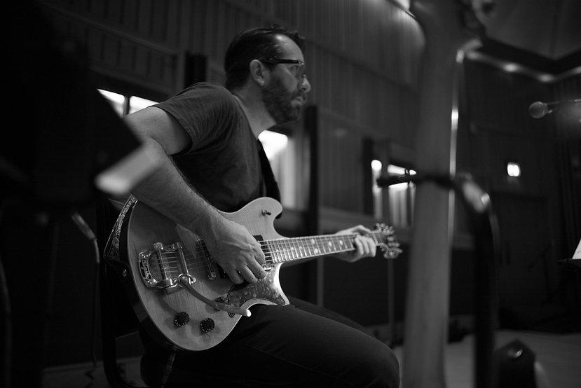 Marcus w guitar playing 2.jpg