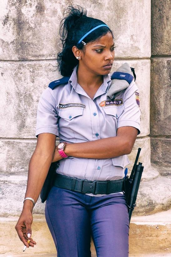 Police woman smoking, Havana