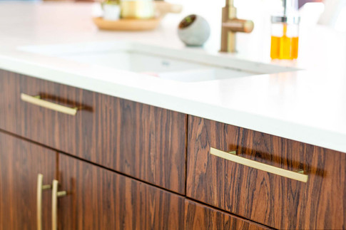 Custom work, kitchen sink cabinets with brown drawers by Wood Products Unlimited
