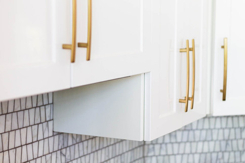 kitchen uppers detail, white cabinets -Wood Products Unlimited.jpg