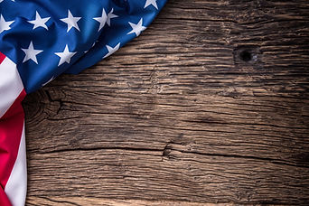 American flag on old wooden board..jpg