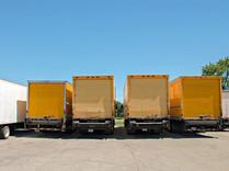 Four Yellow Trucks