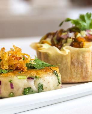 "A traditional indian food dish ""Aloo Tikki"" served with chunna masala."