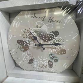 Horloge décoration plumes