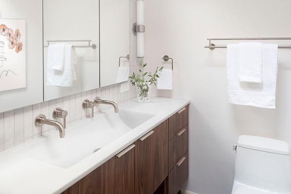 Natural Walnut Vanity, Delta Trinsic wall-mounted faucets