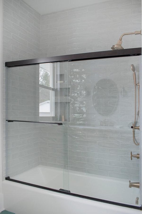 Shiloh Cabinetry, Kohler Margaux, Black shower door,  Shower niches, Zurich white, Gold hardware