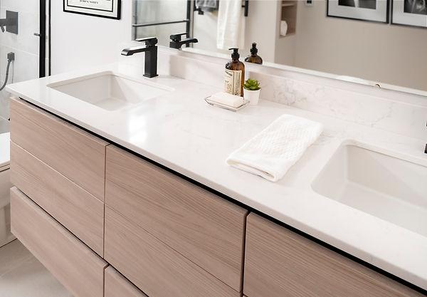 Agalite shower door, Gola Channel,Milestone North porcelain tile, black hardware, Eclipse cabinetry Natural elm, Kohler Verticyl lavatory, Nu-Heat