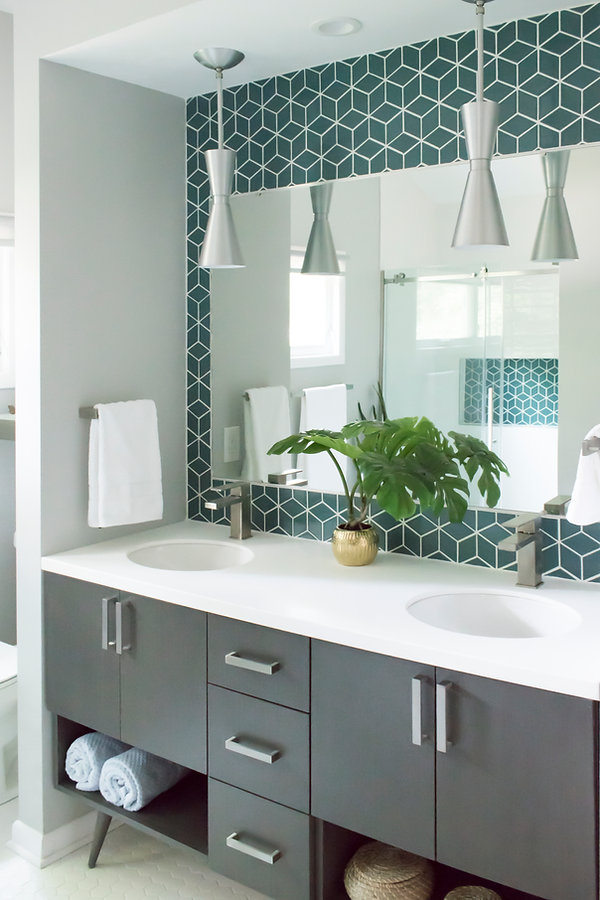 Eclipse cabinetry, Lip Pull, Corian Cameo White vanity tops, Kohler Caxton sink, Delta Angular Faucet, Fireclay accent tile, Galaxy pendant Brushed aluminum, Floating shelf