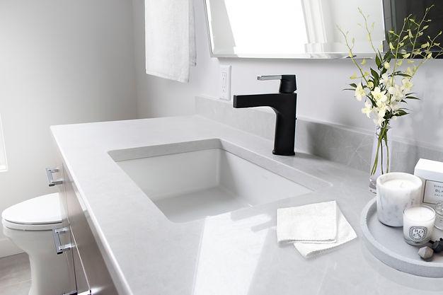 Porcelainosa Dover caliza tile, Stone One Silver porcelain tile, Ceasarstone Cosmopolitan White, Delta Zura, Kohler Clarabelle, Kohler Verticyl, Restoration Hardware mirror, Sail Mirror