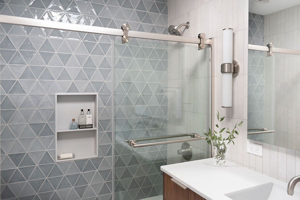 Bellami Triangulo Azul, Custom Corian shower niche, Delta Trinsic fixtures in stainless, Altered state white hot mosaic wall tile, custom Kohler recessed medicine cabinet