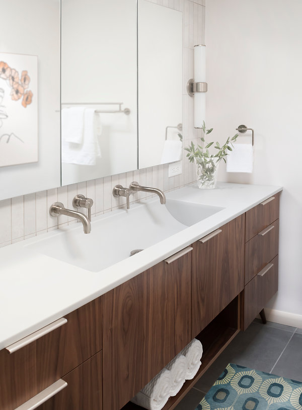 Delta Trinsic wall-mounted faucets, custom sink, Rigdon Double Tube Wall Sconce, Virginia Tile, Eclipse Walnut vanity