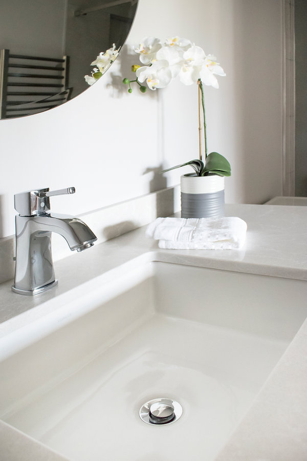 Shiloh Cabinetry, Ceasarstone cosmopolitan white, Milestone South Grey tile, Grohe Grandera tapware, Atlas Tableau hardware, Serenity shower door, Kohler Verticyl