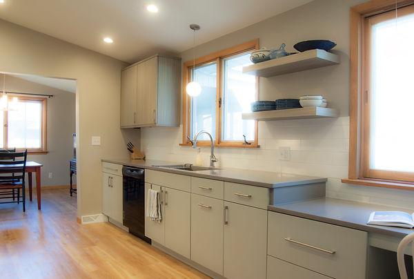 Wood-mode cabinetry Deep Ice / Nantucket, Floating shelves, Docking drawer, Silestone Grey Expo, Delta Trinsic Faucet, Kohler Strive Sink, Karndean Van Goh French oak, LBL Zolo pendants