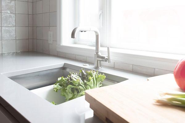 Eclipse Cabinetry, Gola Channel, Matte white, Kohler Purist faucet, Kohler prolific sink, Natural maple wall cabinets, Floating shelves, Silestone Kensho Quartz, Mestizaje White Zellige splash tile