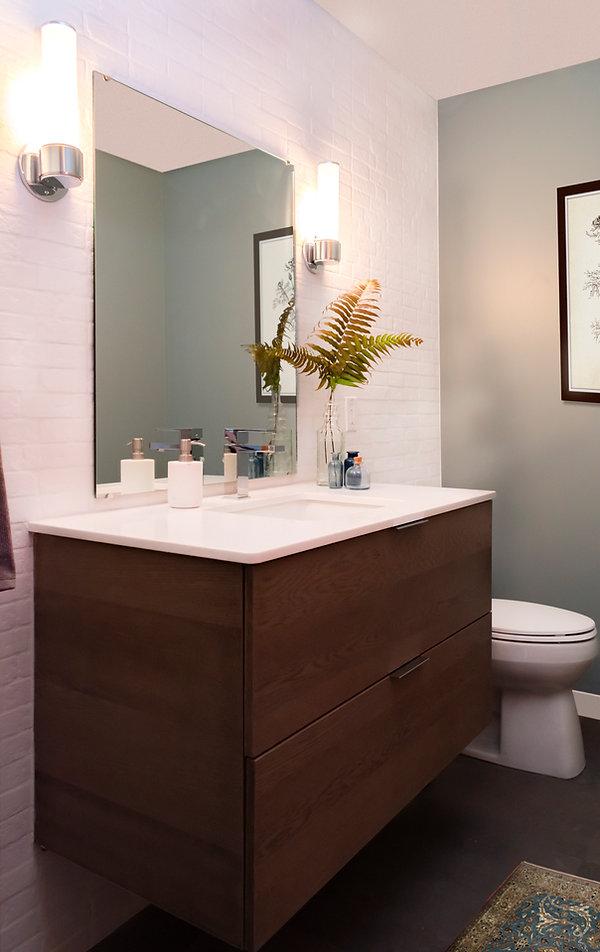 Floating vanity, Kohler Verticyl lavatory, Kohler Santa Rosa Toilet, Rejuvenation Rigdon wall sconce, Delta Ara Tapware