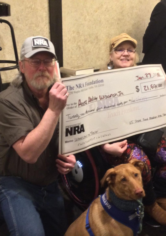 Monica receive the check from the Friends of the NRA