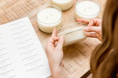 Placing labels on Meeraboo jars.