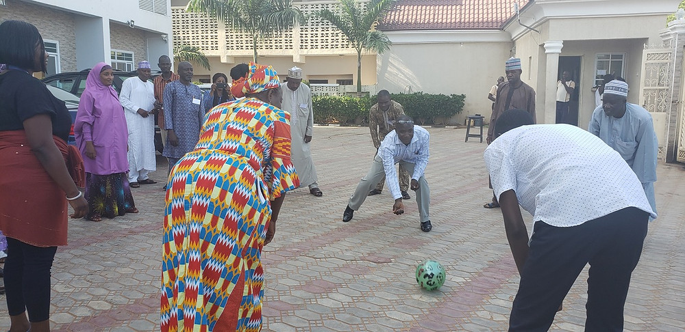 Stakeholders playing with a ball