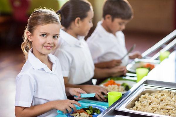 schoolgirl-with-classmate-standing-near-