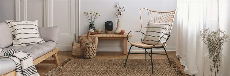 House styling done with jute rug, lounge and natural fibres in loungeroom, by Home Property Styling