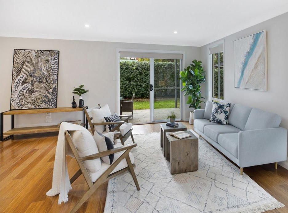 Lounge setting using sky blue lounge, ornate rug, dual coffee tables, occassional chairs, console and artworks by Home Property Styling