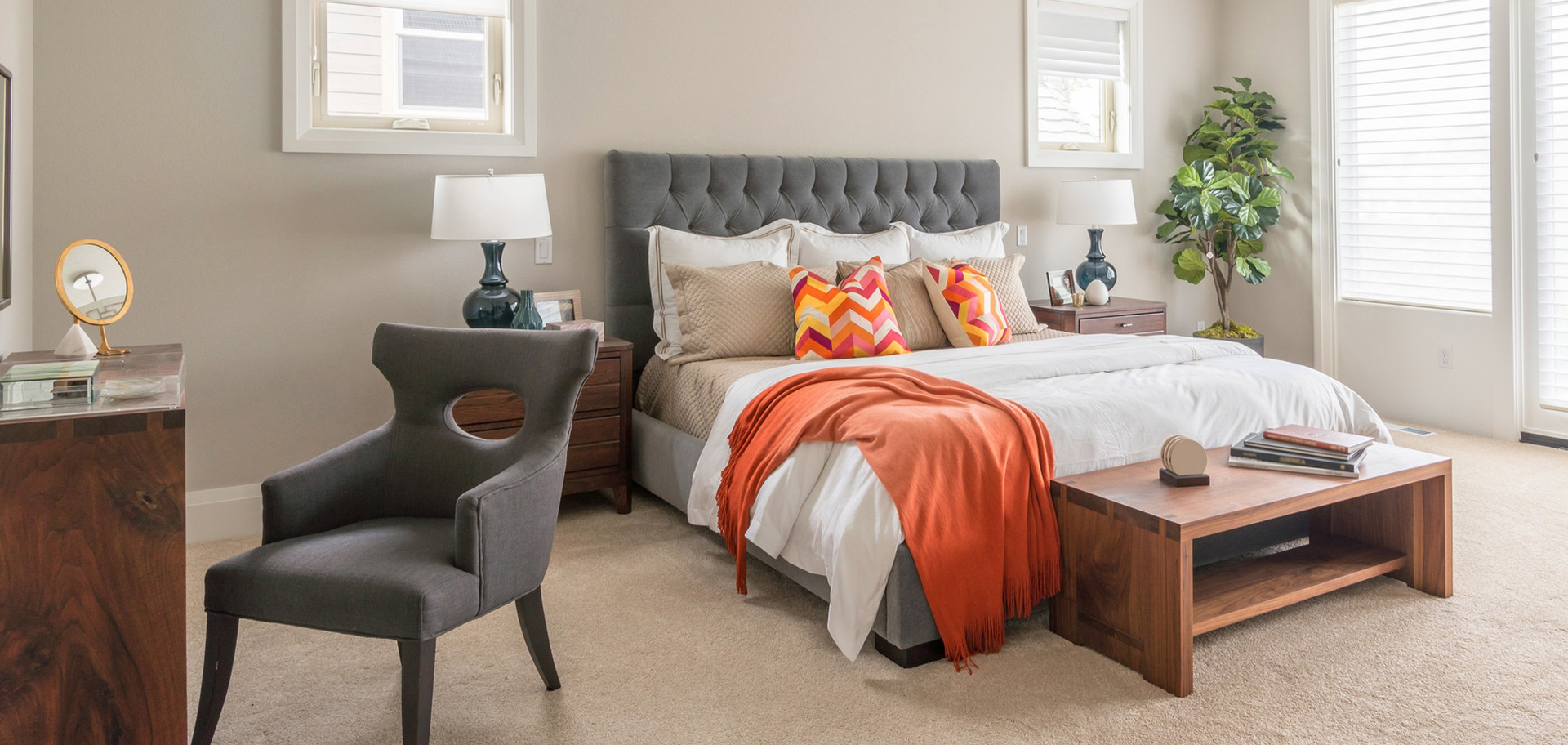 Bedroom with side table and bedhead, Autumn coloured throws of burnt orange.jpg